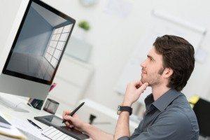 Biznesmen za pomocą tabletu i pióra do nawigacji