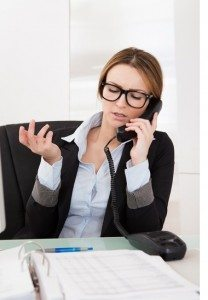 Beautiful Businesswoman Talking On Telephone In Office