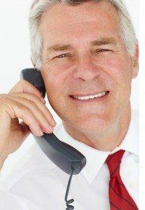 Senior businessman on phone